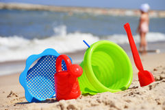 Plastic children toys on the sand beach Royalty Free Stock Photos