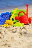Plastic children toys on the sand beach Royalty Free Stock Photo