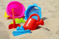 Plastic children toys on the sand beach.  Stock Photo