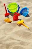 Plastic children toys on the sand beach.  Royalty Free Stock Images