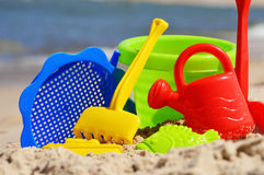 Plastic children toys on the sand beach.  Stock Images