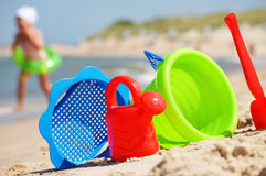Plastic children toys on the sand beach.  Royalty Free Stock Image