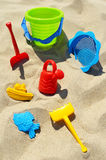 Plastic children toys on the sand beach.  Royalty Free Stock Photography