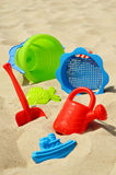 Plastic children toys on the sand beach Stock Images