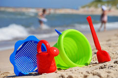 Plastic children toys on the sand beach Stock Photo