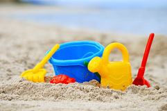 Plastic children toys on the sand beach Stock Photo