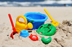 Plastic children toys on the sand beach.  Royalty Free Stock Photos