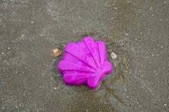 Plastic children toys. On the sand beach Stock Photo
