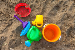 Plastic children toys on the sand Stock Photos