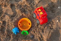 Plastic children toys on the sand Royalty Free Stock Photography