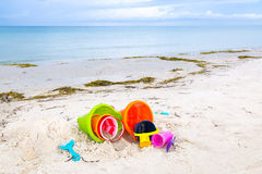 Plastic children toys on the sand beach. Selective focus Stock Photos