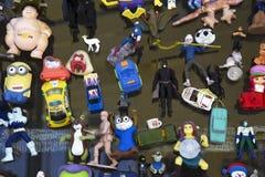 Plastic chotskies toys of super heroes, cars displayed in window, Ventura, California, USA Stock Photo