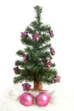 Plastic christmas tree with purple stars Stock Image