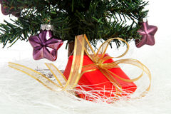 Plastic christmas tree with red present Stock Image