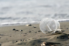 Plastic class. Environmental pollution - plastic class , dirt in a beach Royalty Free Stock Image