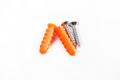 Plastic cleat  and screw on white Royalty Free Stock Photos
