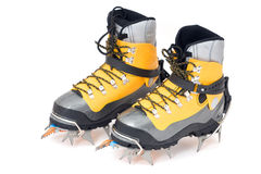 Plastic climbing boots with crampons. Isolated on white background stock photos