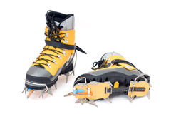 Plastic climbing boots with crampons. Isolated on white background royalty free stock photos