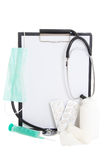 Plastic clipboard with blank paper sheet and medical supplies is Stock Photography