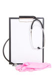 Plastic clipboard with blank paper sheet, stethoscope and pink r Royalty Free Stock Photo