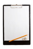 Plastic Clipboard with metal clip. Blank paper Royalty Free Stock Photo
