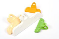 Plastic clips over white Royalty Free Stock Images