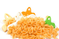 Plastic clips and pasta Stock Photography