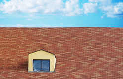 Plastic cloth on a skylight in a tile roof Stock Images