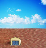 Plastic cloth on a skylight in a tile roof Royalty Free Stock Photography