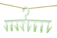 Plastic clothes hanger with hanging pegs Royalty Free Stock Images