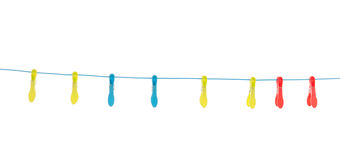 Plastic clothes pegs. Hanging at laundry line Royalty Free Stock Image