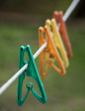 Plastic clothes pegs on a line. Pegs on a clothes line Stock Image