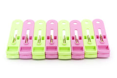 Plastic clothes pegs over white Stock Photo