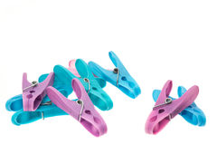 Plastic clothes pegs Stock Images