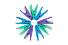 Plastic clothes pegs on a white background Royalty Free Stock Photos