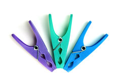 Plastic clothes pegs on a white background Stock Photography
