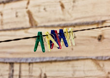 Plastic clothes pins on a rope, nature background Royalty Free Stock Photos