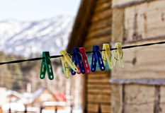 Plastic clothes pins on a rope, nature background Stock Images