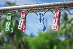 Plastic clothespin on a clothesline. Plastic clothespin on a clothesline and in the daytime sky Stock Image