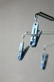 Plastic clothespin. Threes blue plastic clothespin hang on wall Stock Photography