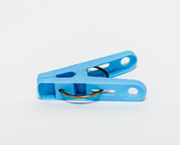 Plastic clothespin on white background Stock Image