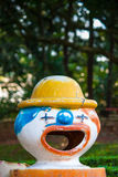 Plastic clown trashcan/wastebasket in an amusement park Royalty Free Stock Images