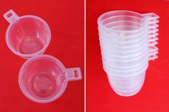 Plastic coffee cups. Empty plastic coffee cups on red background Royalty Free Stock Photo