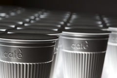 Plastic coffee cups in line Stock Photography