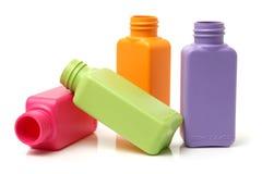 Plastic color bottles Stock Photos