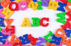 Plastic colored alphabet letters ABC on a white Stock Photo