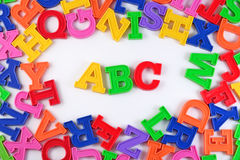 Plastic colored alphabet letters ABC on a white Stock Image