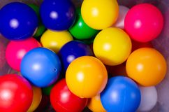 Plastic colored children balls. Bright round balls for children pools and games royalty free stock photos