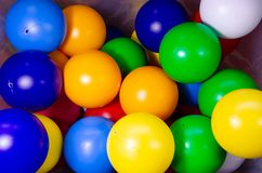 Plastic colored children`s balls. Bright round balls for children`s pools. And games stock photography