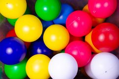 Plastic colored children`s balls. Bright round balls for children`s pools. And games royalty free stock photography